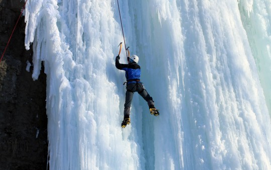 Ice-climbing at the waterfall in Obertauern, Austria